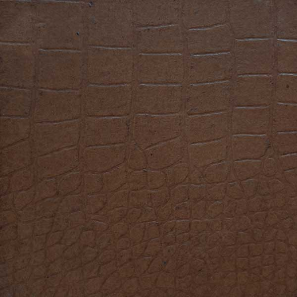 Crocodile-embossed leather in coffee bean
